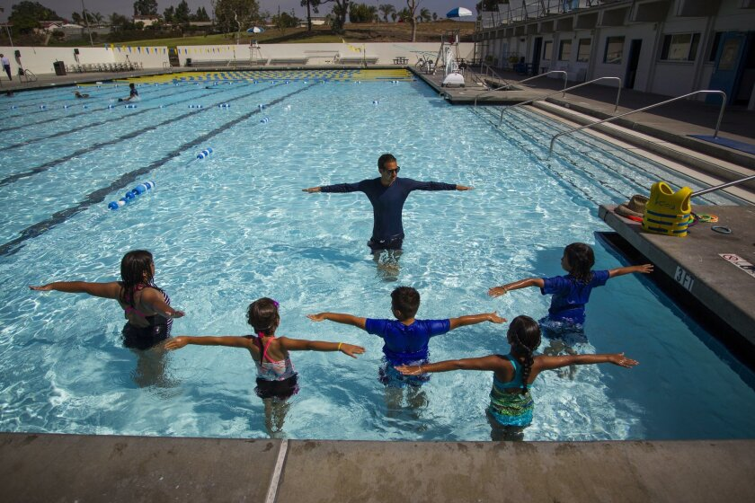 """Fourth-graders from Greg Rogers Elementary, adjacent to the Loma Verde Aquatic Center in Chula Vista, practice the """"monkey, airplane, soldier"""" swim technique during as part of the Operation Splash, a swimming program funded by Kaiser Permanente and the Friends of Chula Vista Parks and Rec Dept."""