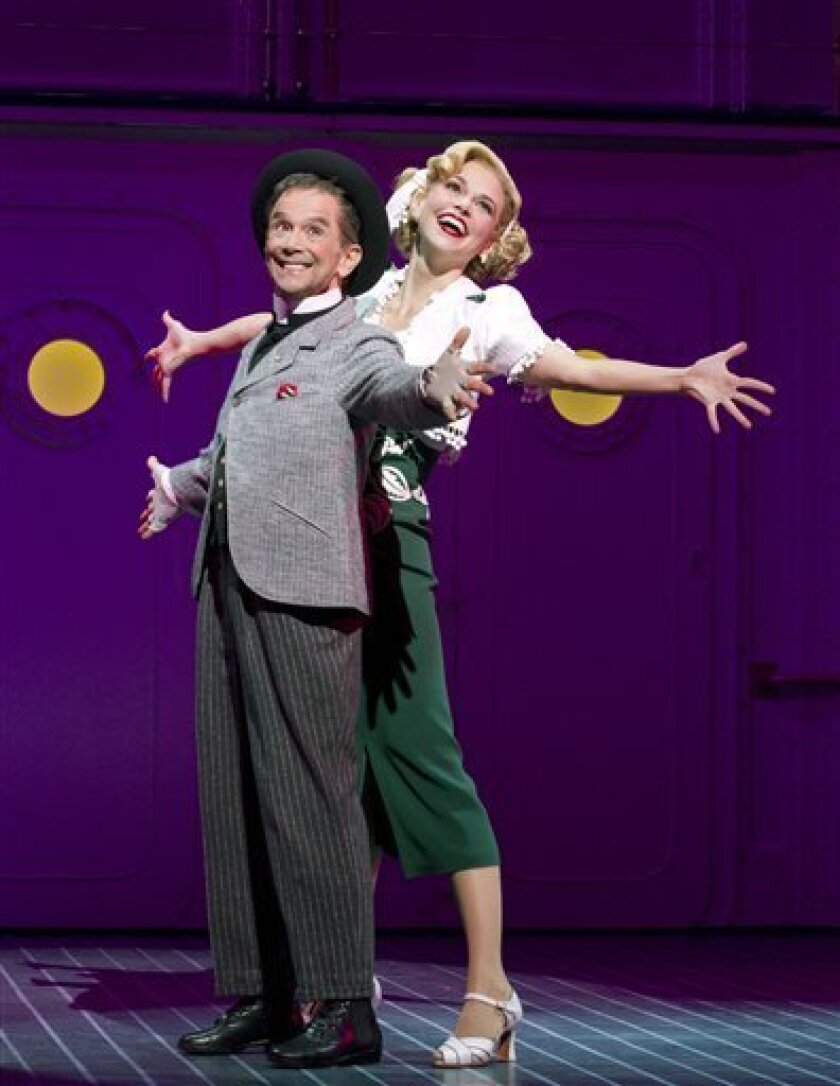 "In this theater publicity image released by Boneau/Bryan-Brown, Joel Grey, left, and Sutton Foster are shown during a performance of ""Anything Goes,"" opening April 7, 2011 in New York. (AP Photo/Boneau/Bryan-Brown, Joan Marcus)"