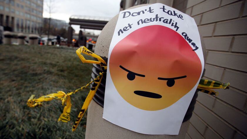 """A sign with an emoji reads """"Don't take net neutrality away"""" is posted outside the Federal Communicat"""