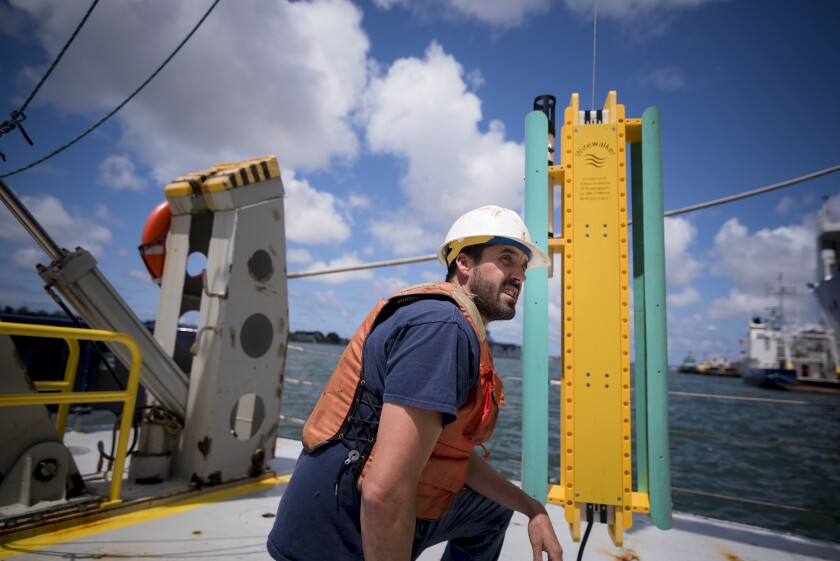Drew Lucas with the Wirewalker on the Scripps Oceanography Research Vessel Robert Gordon Sproul.