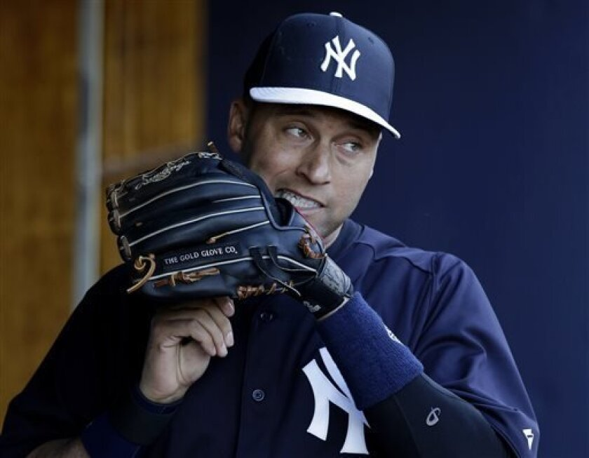 FILE - In this March 13, 2013, file photo, New York Yankees shortstop Derek Jeter adjusts the laces on his glove before a spring training baseball game against the Philadelphia Phillies in Tampa, Fla. The Yankees said Thursday, April 18, 2013, that Jeter will be sidelined until after the All-Star b