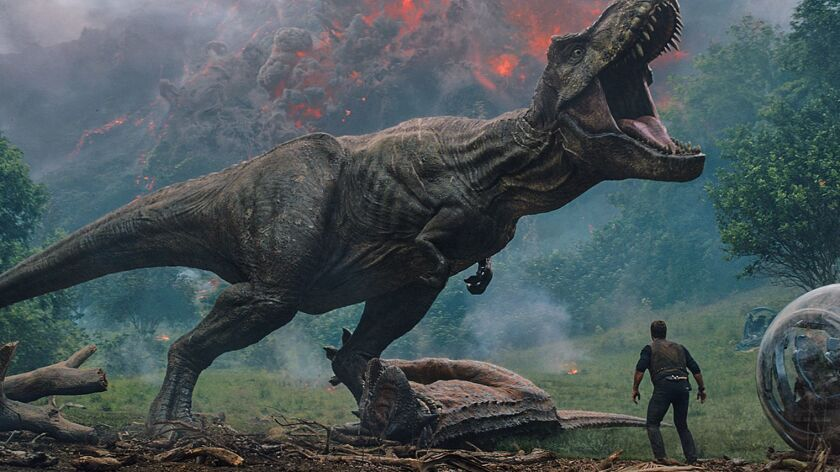 2482-TPT-00001R-GRD Owen (CHRIS PRATT) meet the vicious T. rex in Jurassic World: Fallen Kingdom.