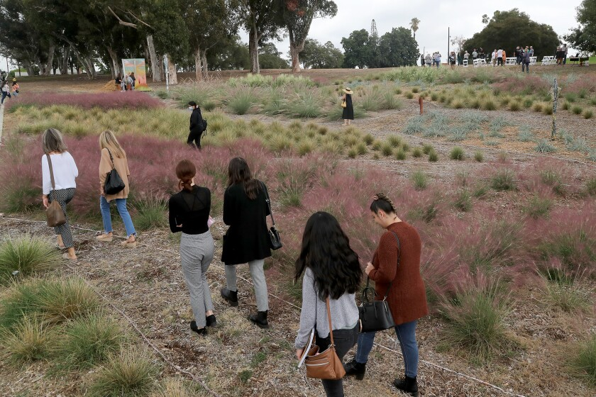 """Visitors walk through the new """"Sunset Garden"""" on Tuesday at the Muckenthaler Cultural Center in Fullerton."""