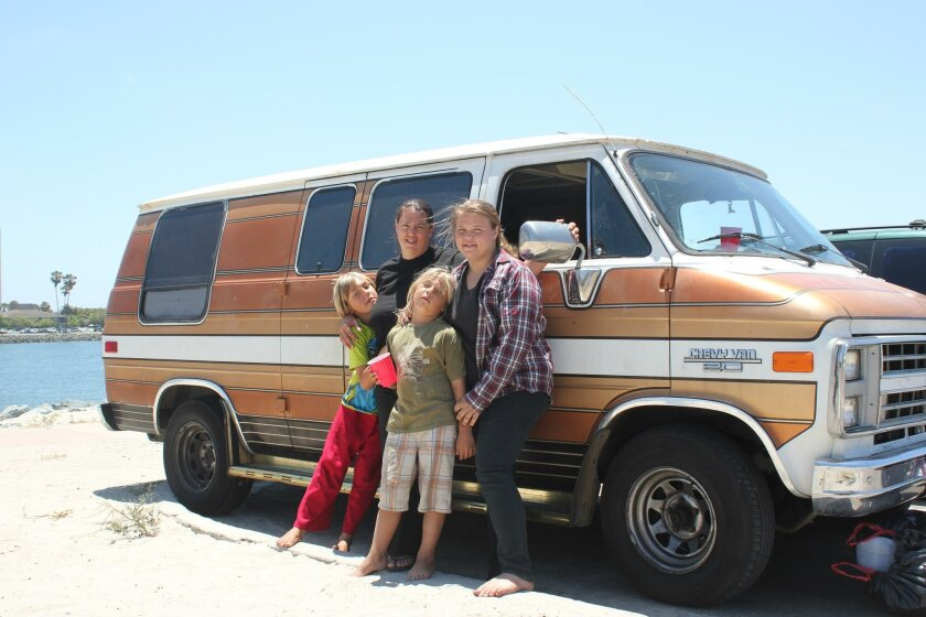 Ruby, Kayla, Julian and Aeury Johnson live in a 1987 Chevy van with two other family members.