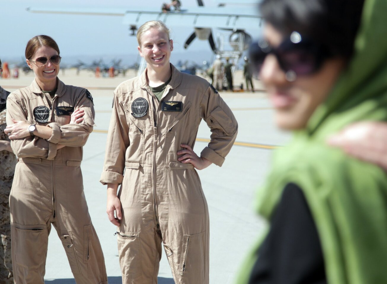 Captain Rahmani, the first Afghan female military fixed wing pilot, right, met with Miramar personnel like Marine 1st. Lt. Alisa Sieber, left and Marine Capt. K.C. Koepp.