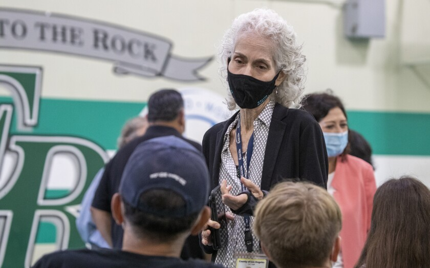 Barbara Ferrer talks at a vaccine clinic.