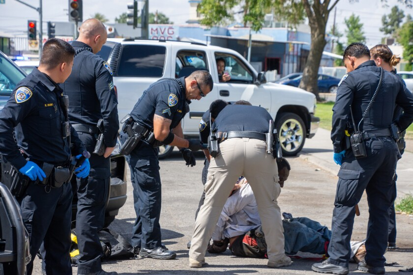 In this Friday, May 21, 2021, photo, Bakersfield Police Department officers respond to an incident at Martin Luther King Jr. Park in southeast Bakersfield, Calif. (Anne Daugherty/California Reporting Project via AP)