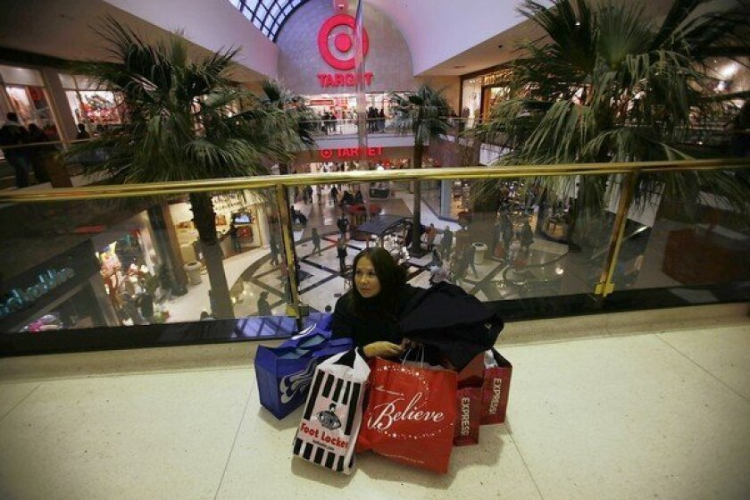 Loaded down with purchases, a shopper rests a moment at the Glendale Galleria during the 2010 Thanksgiving weekend. She'd been shopping since 4 a.m.