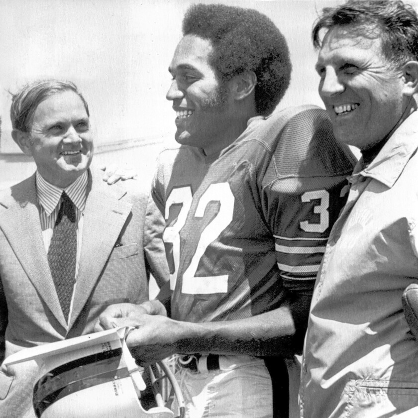 Buffalo Bills founder Ralph Wilson, left, with O.J. Simpson, center, and coach Lou Saban in 1972.
