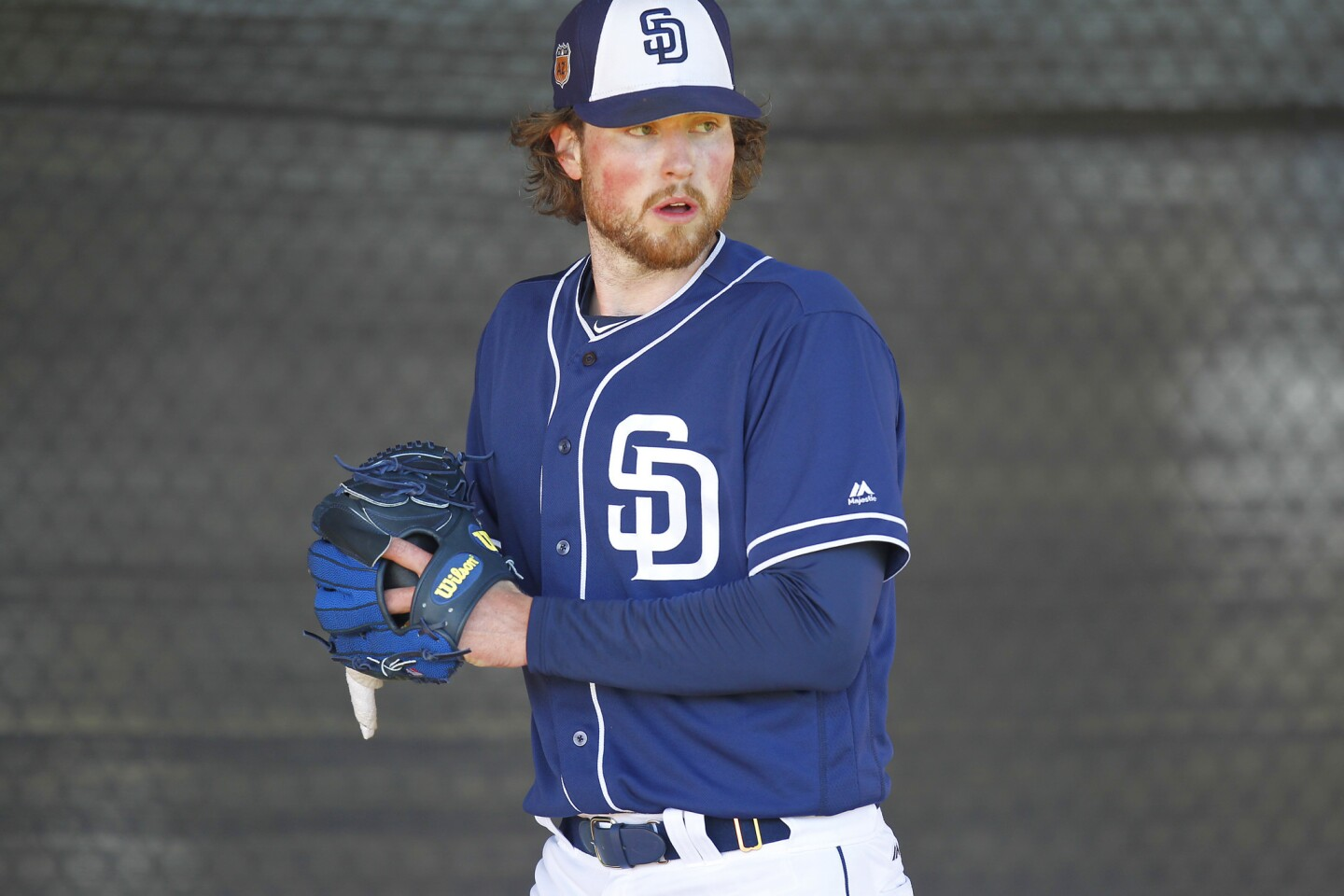 San Diego Padres Carter Capps pitches during a spring training practice. (Photo by K.C. Alfred/The San Diego Union-Tribune)