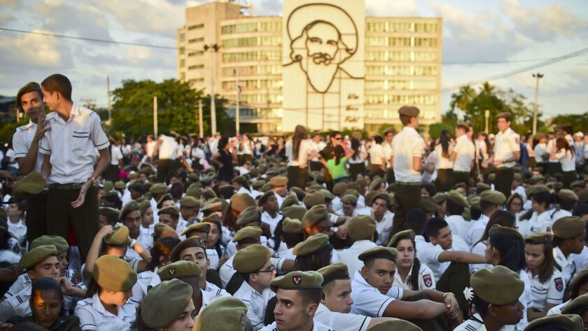 Students gather at Revolution Square to pay homage to late Cuban revolutionary leader Fidel Castro, in Havana, on November 29, 2016.