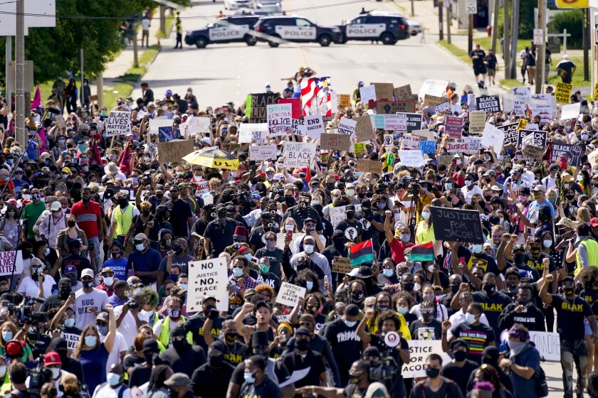 Hundreds march at a rally for Jacob Blake in Kenosha, Wis.