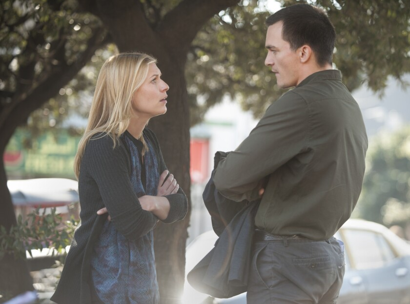 """Carrie Mathison (Claire Danes), CIA station chief in Islamabad, engages in a heated exchange with black ops specialist Peter Quinn (Rupert Friend) on """"Homeland."""""""
