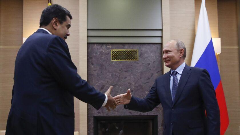 Russian President Vladimir Putin, right, greets his Venezuelan counterpart Nicolas Maduro during the