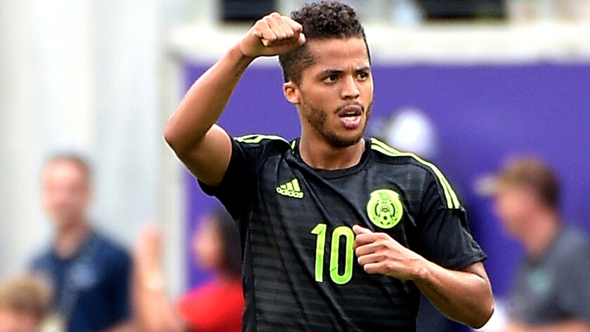 Mexico midfielder Giovani Dos Santos celebrates after scoring a goal during the second half of an exhibition against Costa Rica on June 27