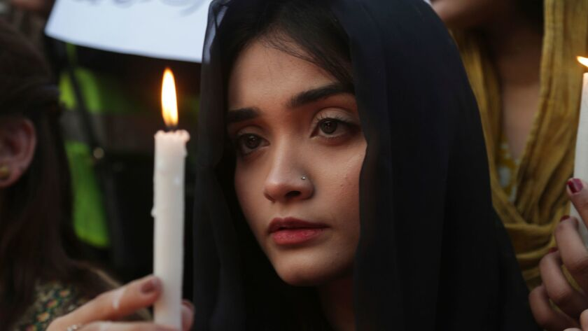 A Pakistani girl joins others during a memorial for Zainab Ansari, an 8-year-old girl who was kidnap