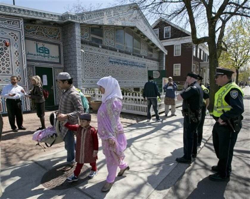 Police stand by as Muslims leave the Islamic Society of Boston mosque, Friday, April 26, 2013, in Cambridge, Mass. Leaders of the Islamic Society of Boston said Tamerlan Tsarnaev occasionally attended Friday prayers, but had protested the community's moderate approach. (AP Photo/Robert F. Bukaty)