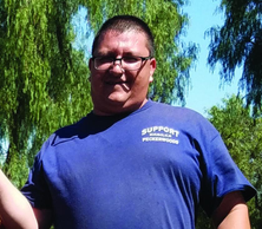 "Chad Alvarez wearing a ""Support Peckerwoods"" T-shirt"