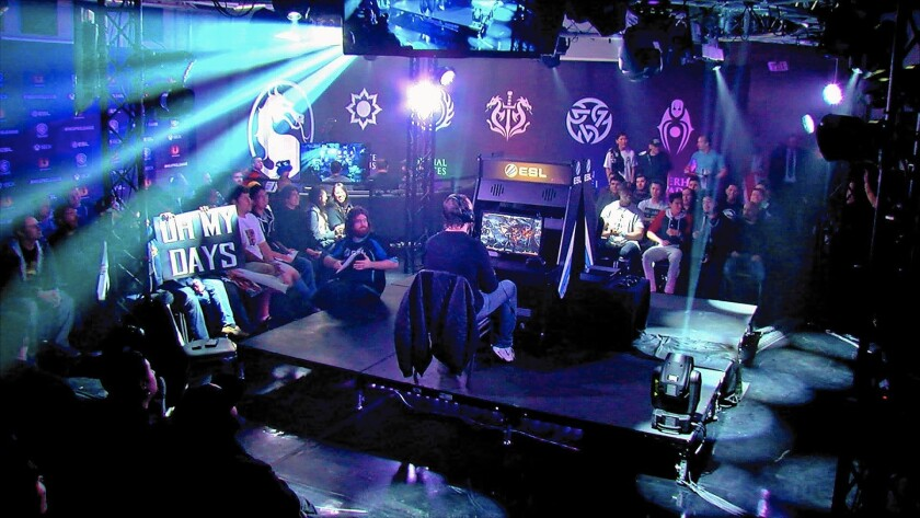 """Top """"Mortal Kombat X"""" players compete in a tournament for the game. """"Chasing the Cup,"""" a show based on the tournament, aired on the CW television network."""