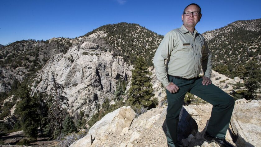 Matthew Bokach, manager of the San Gabriel Mountains National Monument, is leading a Forest Service plan to reopen climbing on the granite face of Williamson Rock, left.