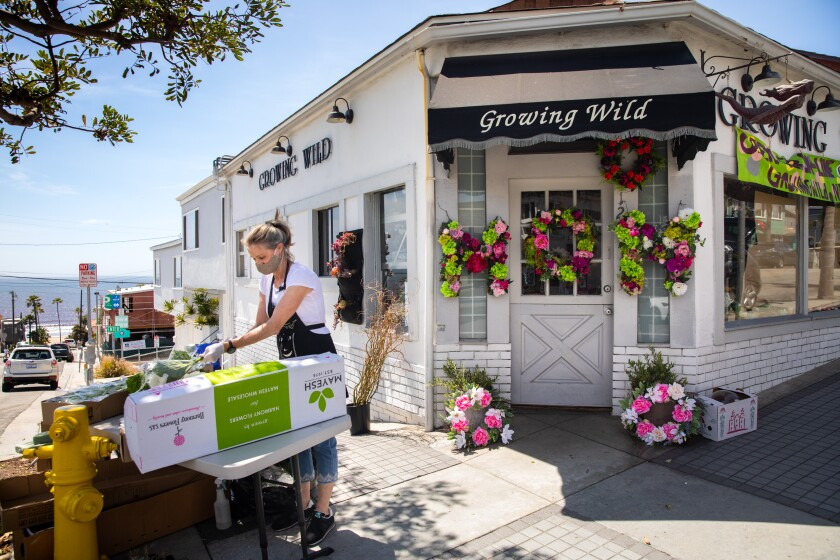 Debra Consani, with the flower shop Growing Wild in Manhattan Beach, prepares for the upcoming Mother's Day holiday and fulfilling online orders.