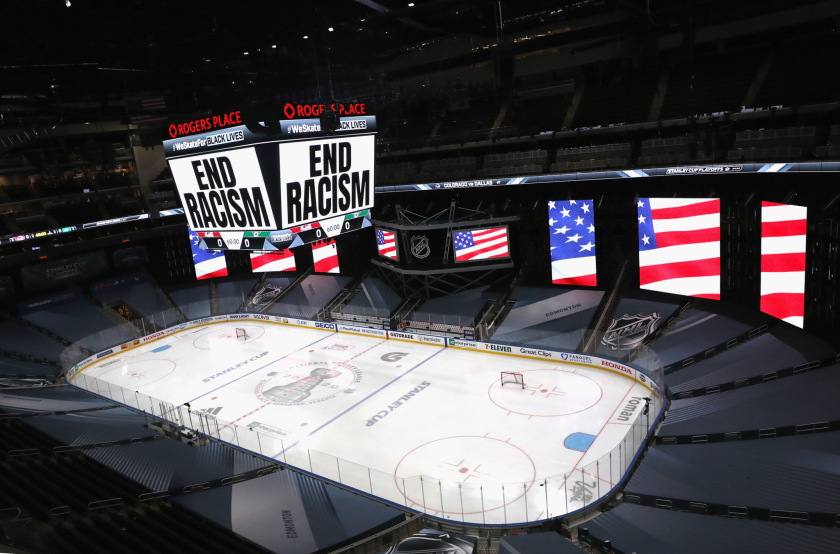 """""""End Racism"""" is displayed on the scoreboard Wednesday at Rogers Place in Edmonton, Canada."""