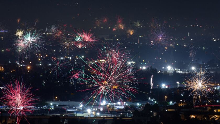 BURBANK, CA - JULY 4: Fireworks over North Hollywood, seen from the Burbank Hills on July 4, 2018 in