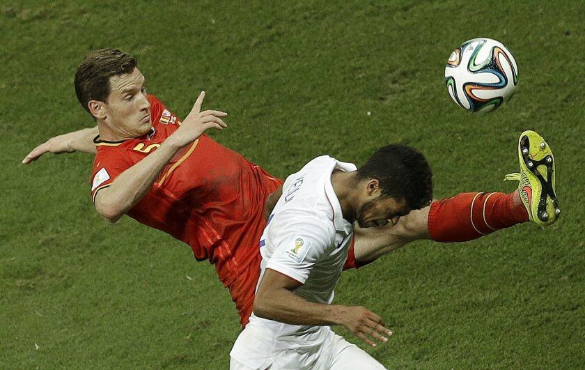 Belgium's Jan Vertonghen, left, and United States' DeAndre Yedlin challenge for the ball during the World Cup round of 16 soccer match between Belgium and the USA at the Arena Fonte Nova in Salvador, Brazil, Tuesday, July 1, 2014. (AP Photo/Themba Hadebe)