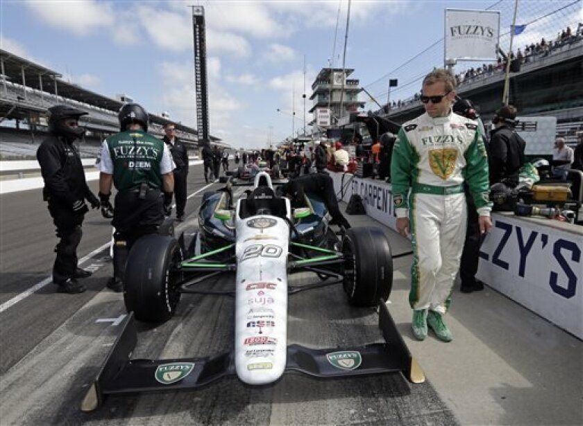 indyCar driver Ed Carpenter, who will start the race from the pole, looks over his car in pit lane before the start of the final practice session for the Indianapolis 500 auto race at the Indianapolis Motor Speedway in Indianapolis, Friday, May 24, 2013. (AP Photo/Darron Cummings)