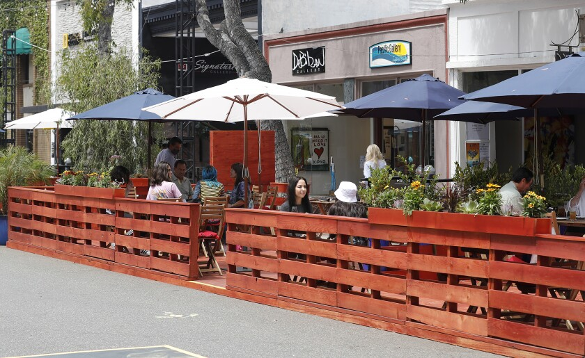 Outdoor dining on newly built decks is one of the new features on the Promenade on Forest in downtown Laguna Beach.