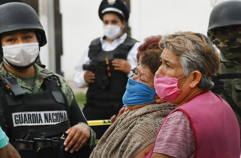 Relatives of  victims wait in anguish for news after a shooting July 1 at a drug rehabilitation center in Irapuato, Mexico.