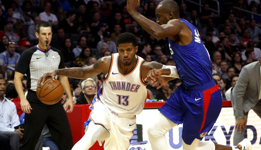 Oklahoma City Thunder's Paul George (13) drives against Los Angeles Clippers' Marcin Gortat (13) dur