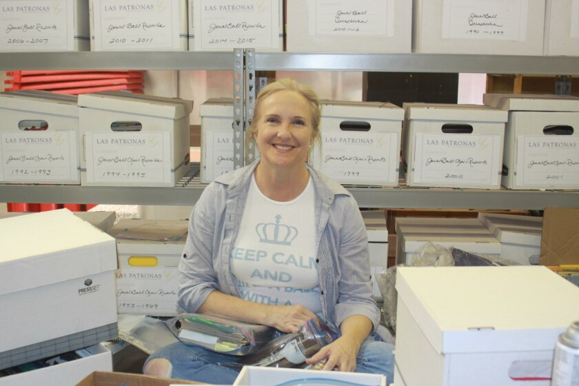 June Fabiani packs away years of planning books and notes in the Las Patronas warehouse in Miramar.