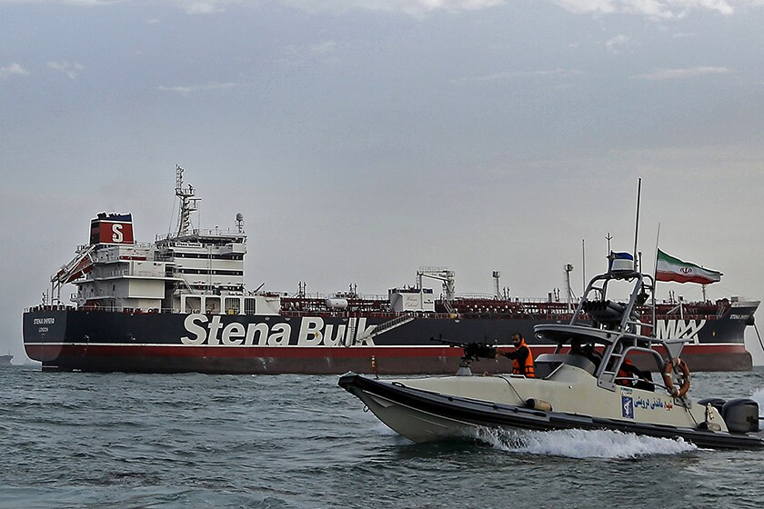 In this July 21 photo, a speedboat of Iran's Revolutionary Guard moves around British-flagged oil tanker Stena Impero, which was seized by the Guard on July 19 in the Iranian port of Bandar Abbas.