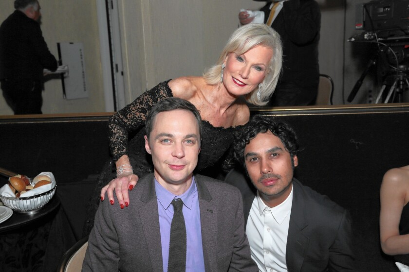"Laurie Burrows Grad, who co-founded A Night at Sardi's with her late husband Peter Grad, poses with ""The Big Bang Theory"" stars Jim Parsons and Kunal Nayyar."