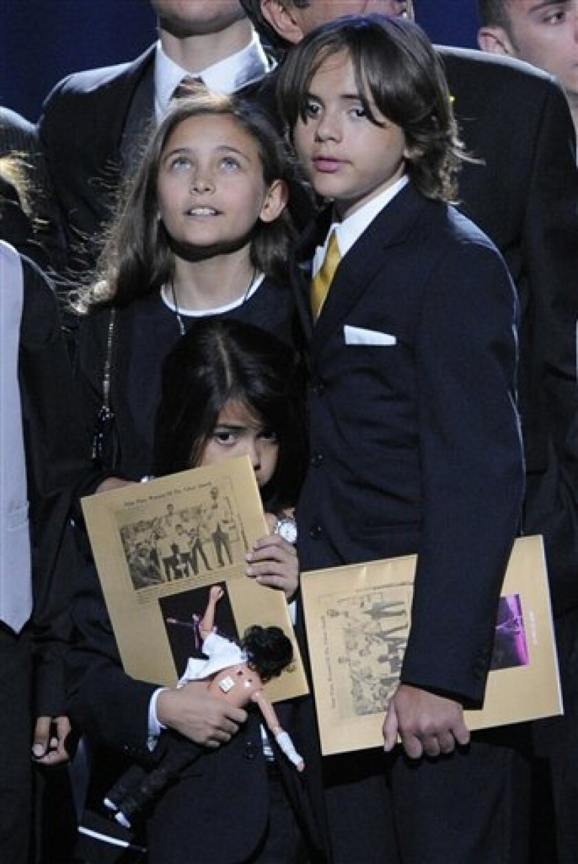 FILE - In this July 7, 2009 file photo, Paris Jackson, left, Prince Michael Jackson and Prince Michael Jackson II appear on stage during the memorial service for Michael Jackson at the Staples Center in Los Angeles. (AP Photo/Mark J. Terrill, Pool)