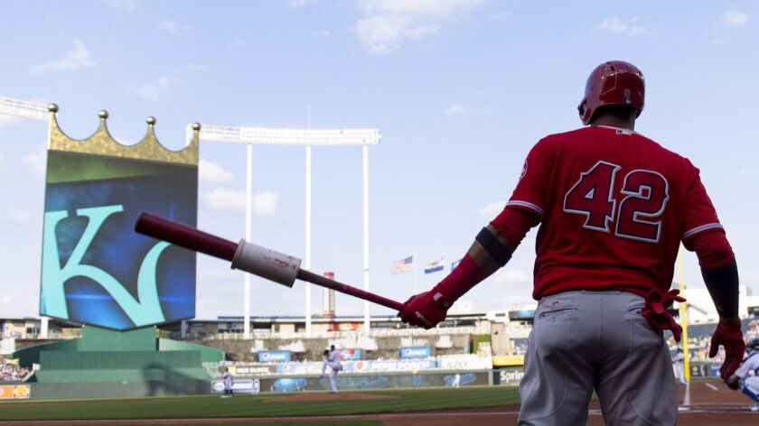 KANSAS CITY, MO - APRIL 15: Yunel Escobar #0 of the Los Angeles Angels of Anaheim warms up before ta