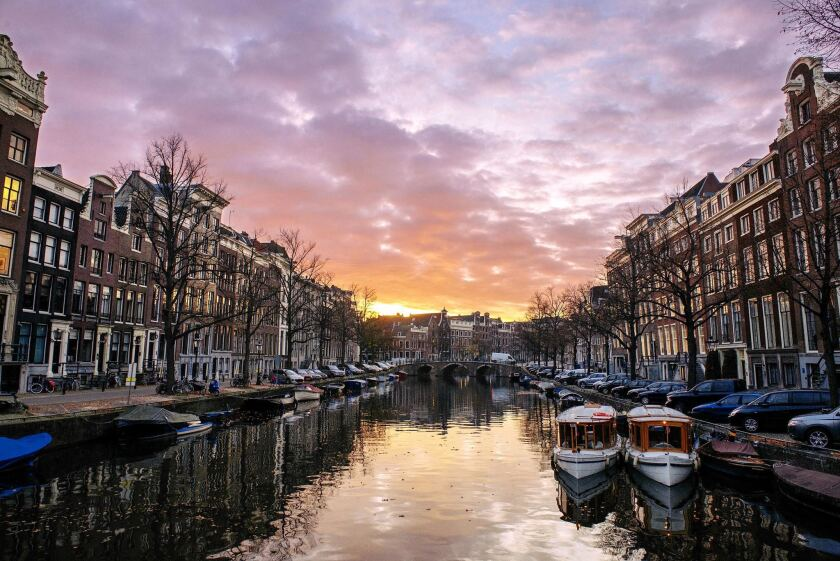 Passengers on the Rhine River cruise will sail through Amsterdam in October.