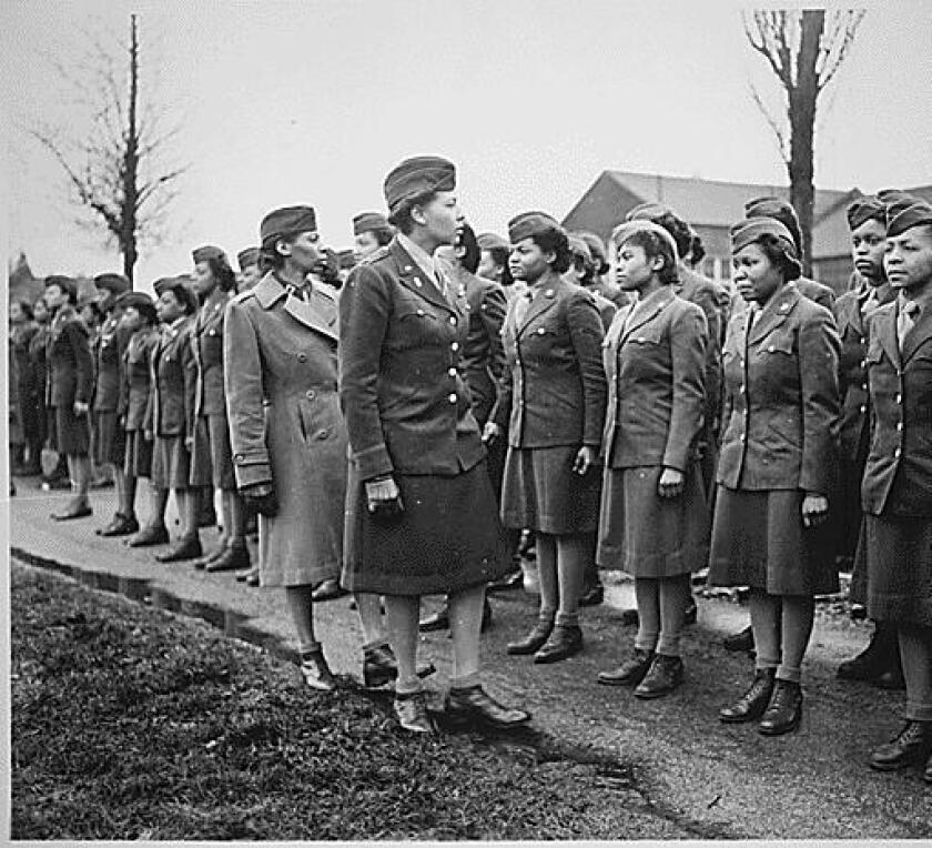 Maj. Charity Adams Earley, front at left, conducts an inspection in 1945 of the 6888th Central Postal Directory Battalion based in England.