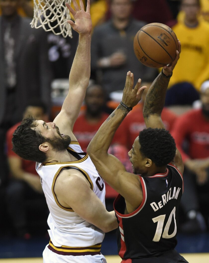 Toronto Raptors guard DeMar DeRozan shoots as Cleveland Cavaliers forward Kevin Love defends during Game 5 of the NBA basketball Eastern Conference finals action in Cleveland on Wednesday, May 25, 2016. (Frank Gunn/The Canadian Press via AP) MANDATORY CREDIT