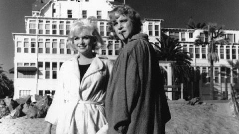 "Marilyn Monroe and Jack Lemmon in front of the Hotel del Coronado during the filming of ""Some Like It Hot."""