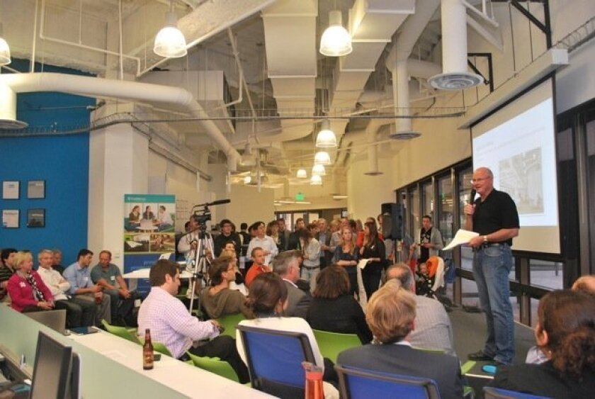 Rory Moore, head of CommNexus, speaks to a group at the EvoNexus incubator in San Diego. Cisco Systems has joined EvoNexus as a sponsor.