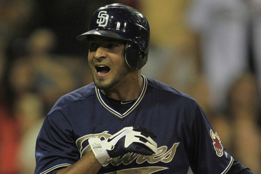 Jesus Guzman of the Padres reacts after striking out with the bases loaded to end the game.
