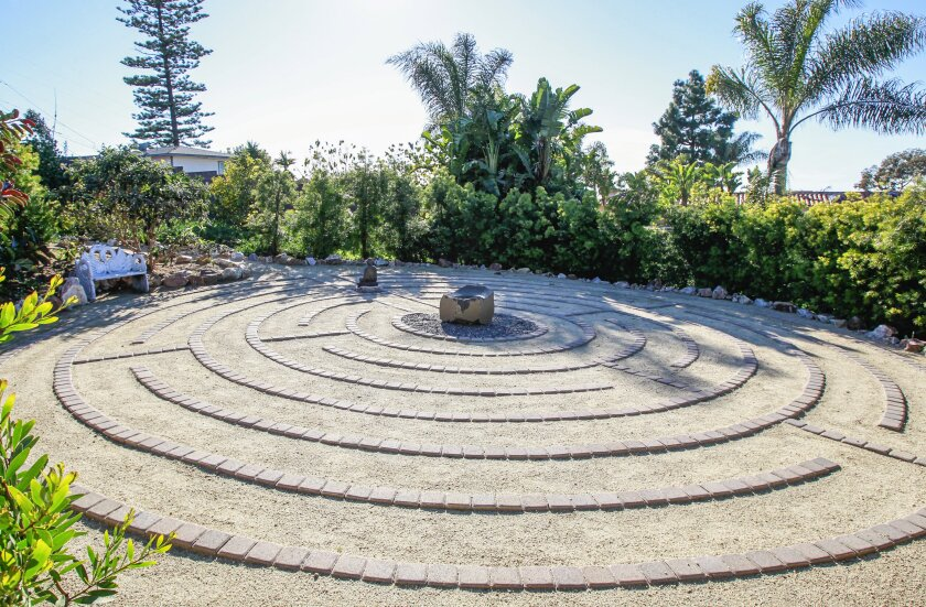 """""""To me, a monochromatic garden with various textures leads to serenity,"""" said Sarah Ruffin, owner of 26Blooms Landscape Design, who created a labyrinth for this 0.4-acre Encinitas garden."""