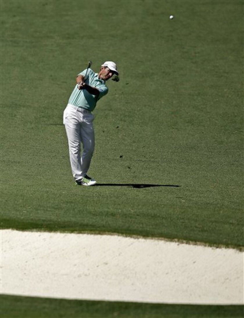 Mike Weir, of Canada, hits off the 10th fairway during the second round of the Masters golf tournament Friday, April 12, 2013, in Augusta, Ga. (AP Photo/Matt Slocum)
