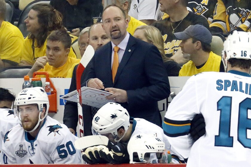San Jose Sharks head coach Peter DeBoer watches action from the bench during the first period in Game 1 of the Stanley Cup final against the Pittsburgh Penguins  series Monday, May 30, 2016, in Pittsburgh. (AP Photo/Keith Srakocic)