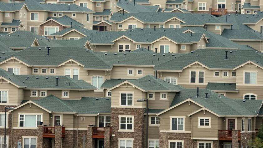 @@*@@* FILE @@*@@* In thsi Thursday, May 4, 2006 file photo, the roofs of houses stack up on a hills