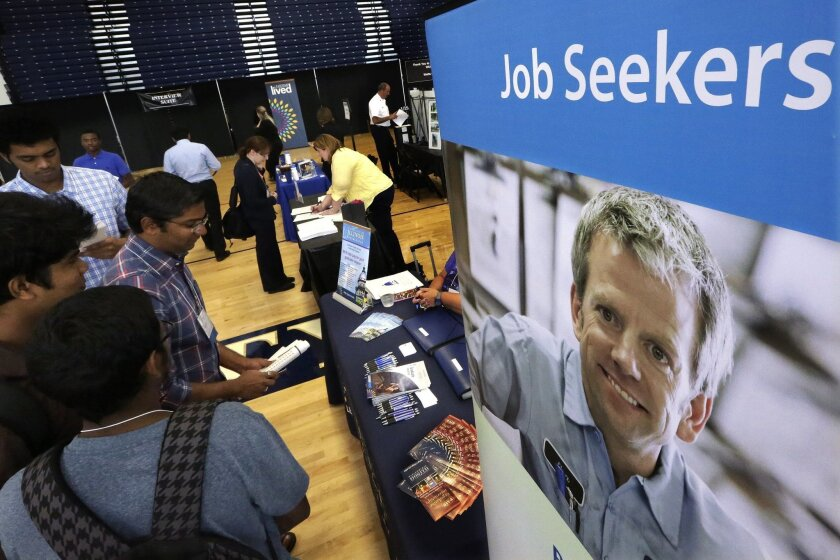 In this Sept. 25, 2014 photo, students attend The Foot in the Door Career Fair at the University of Illinois in Springfield, Ill. The Labor Department releases employment data for September on Friday, Oct. 3, 2014. (AP Photo/Seth Perlman)