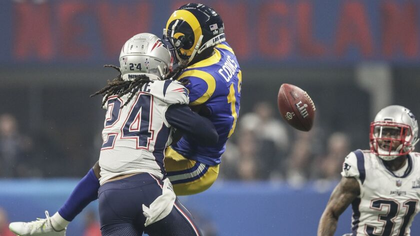 ATLANTA, GEORGIA, FEBRUARY 3, 2019 - Patriots defensive back Stephon Gilmore prevents Rams receiver
