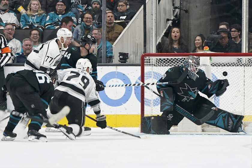 Kings forward Martin Frk scores on Sharks goaltender Aaron Dell.